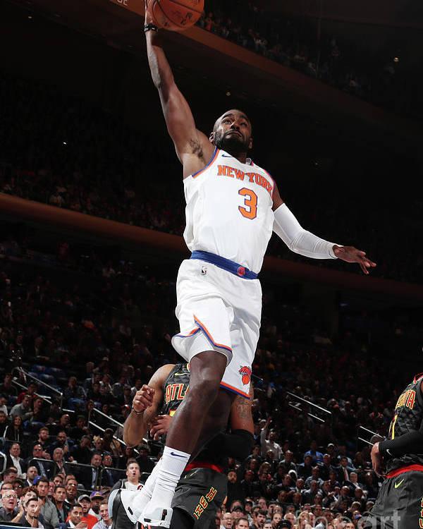 Tim Hardaway Jr. Poster featuring the photograph Atlanta Hawks V New York Knicks by Nathaniel S. Butler