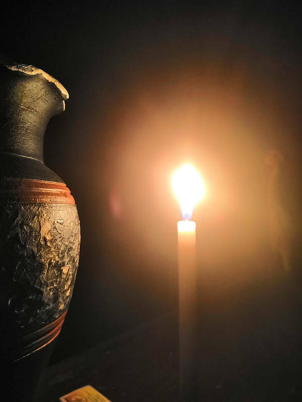 Candle Light Poster featuring the photograph Light In The Dark by Ian Batanda