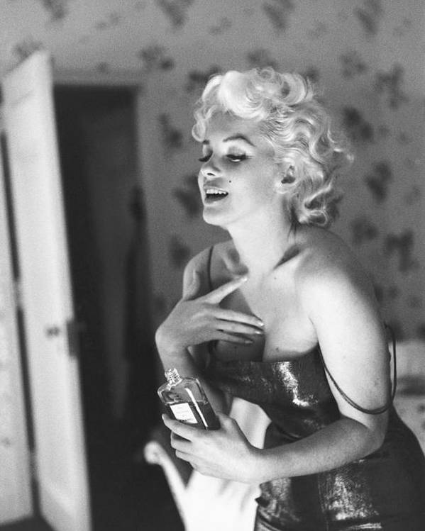 People Poster featuring the photograph Marilyn Monroe With Chanel No. 5 by Michael Ochs Archives