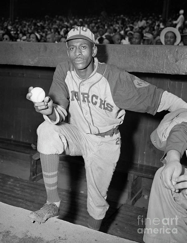People Poster featuring the photograph Pitcher Satchel Paige Standing In Dugout by Bettmann