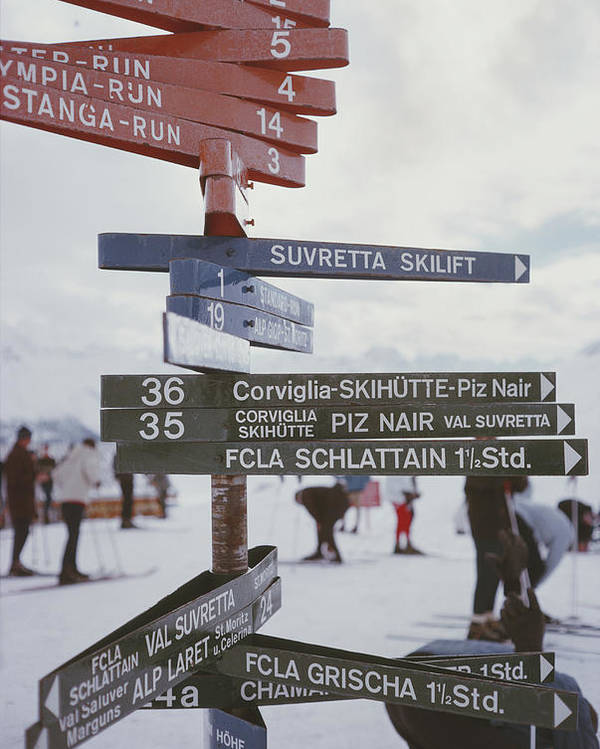 People Poster featuring the photograph Signpost In St. Moritz by Slim Aarons