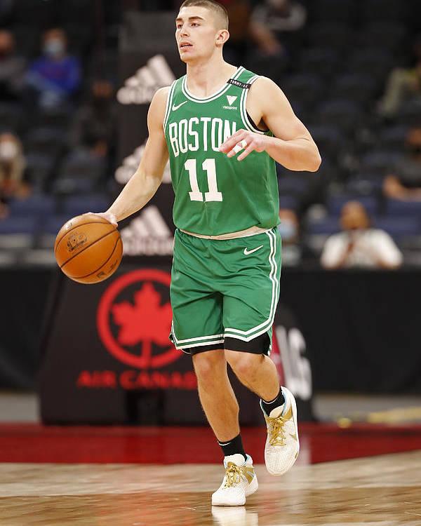 Nba Pro Basketball Poster featuring the photograph Boston Celtics v Toronto Raptors by Scott Audette