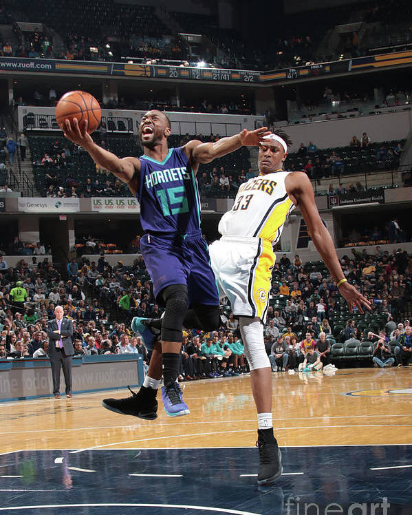 Kemba Walker Poster featuring the photograph Kemba Walker by Ron Hoskins