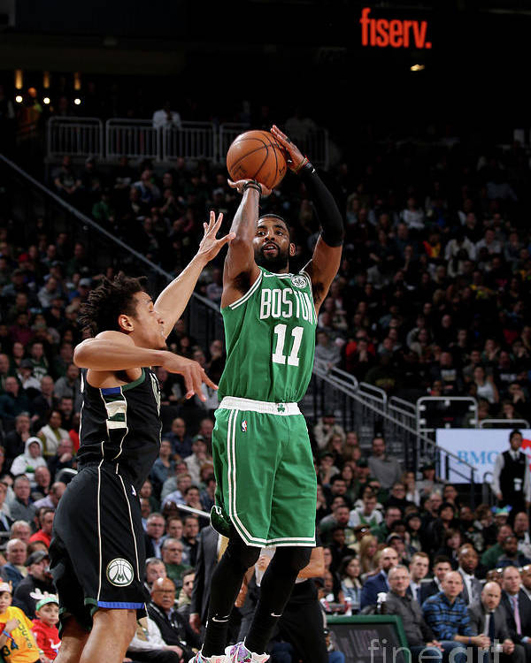 Nba Pro Basketball Poster featuring the photograph Kyrie Irving by Gary Dineen