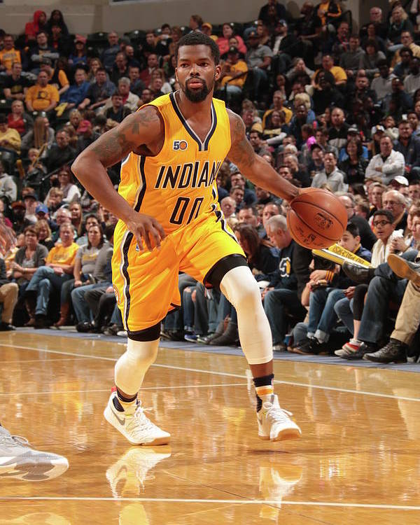 Nba Pro Basketball Poster featuring the photograph Aaron Brooks by Ron Hoskins
