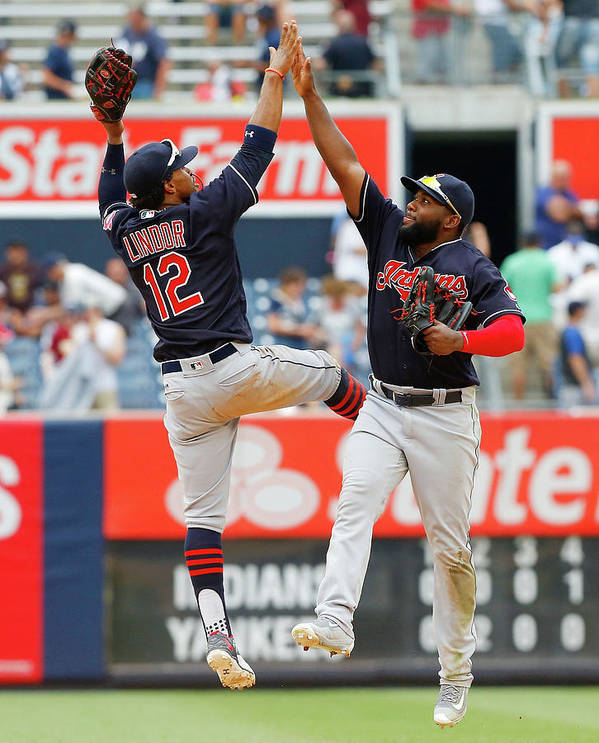 People Poster featuring the photograph Abraham Almonte and Francisco Lindor by Jim Mcisaac