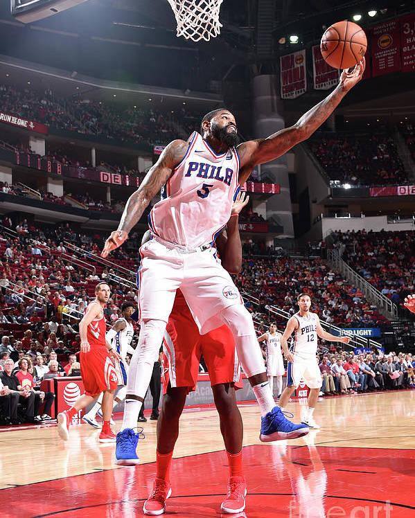 Nba Pro Basketball Poster featuring the photograph Amir Johnson by Bill Baptist