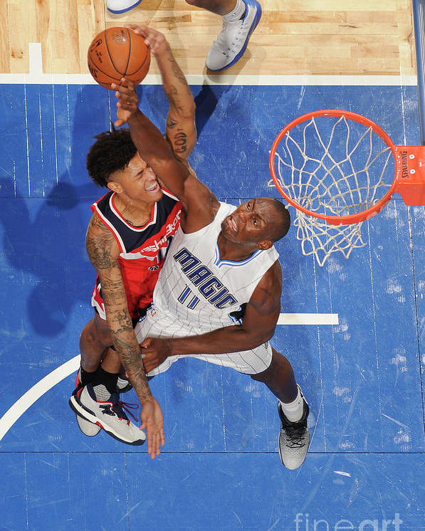 Nba Pro Basketball Poster featuring the photograph Bismack Biyombo and Kelly Oubre by Fernando Medina