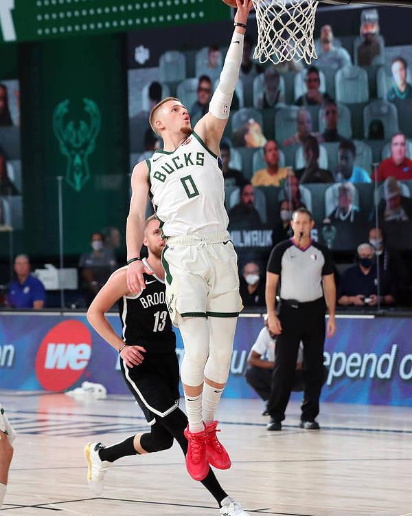 Nba Pro Basketball Poster featuring the photograph Brooklyn Nets v Milwaukee Bucks by Joe Murphy