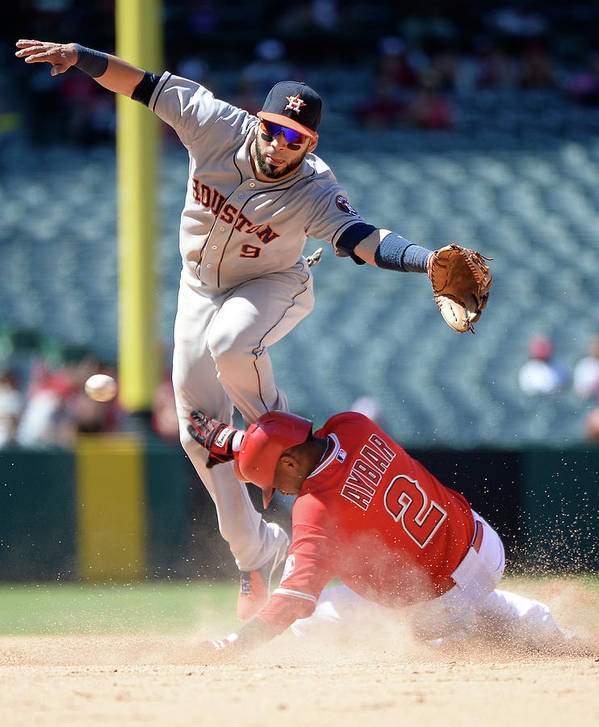 American League Baseball Poster featuring the photograph Carlos Corporan and Erick Aybar by Harry How