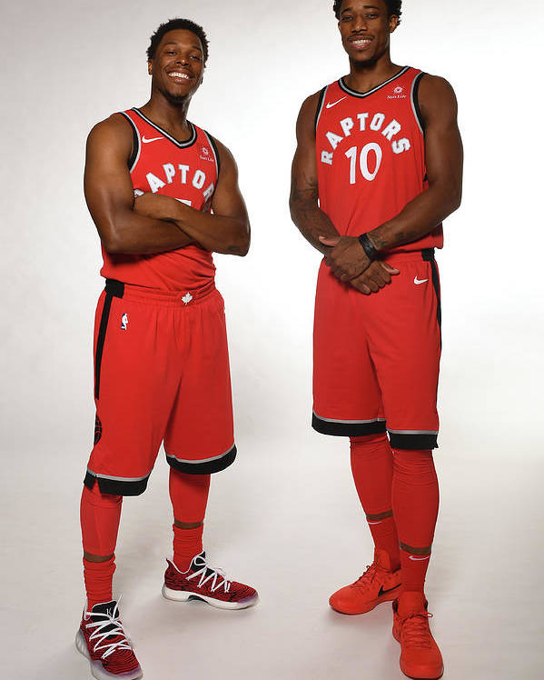 Media Day Poster featuring the photograph Demar Derozan and Kyle Lowry by Ron Turenne