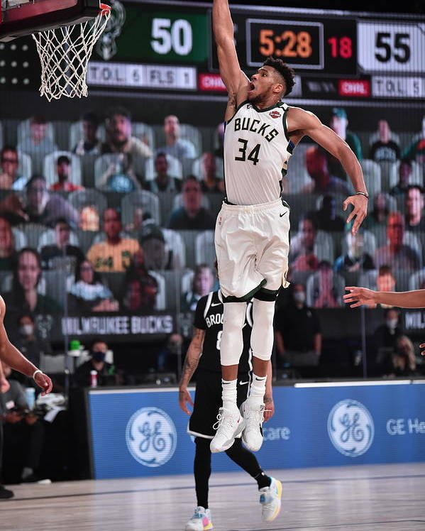 Nba Pro Basketball Poster featuring the photograph Giannis Antetokounmpo by David Dow