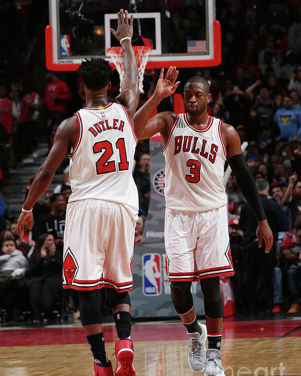 Chicago Bulls Poster featuring the photograph Jimmy Butler and Dwyane Wade by Gary Dineen