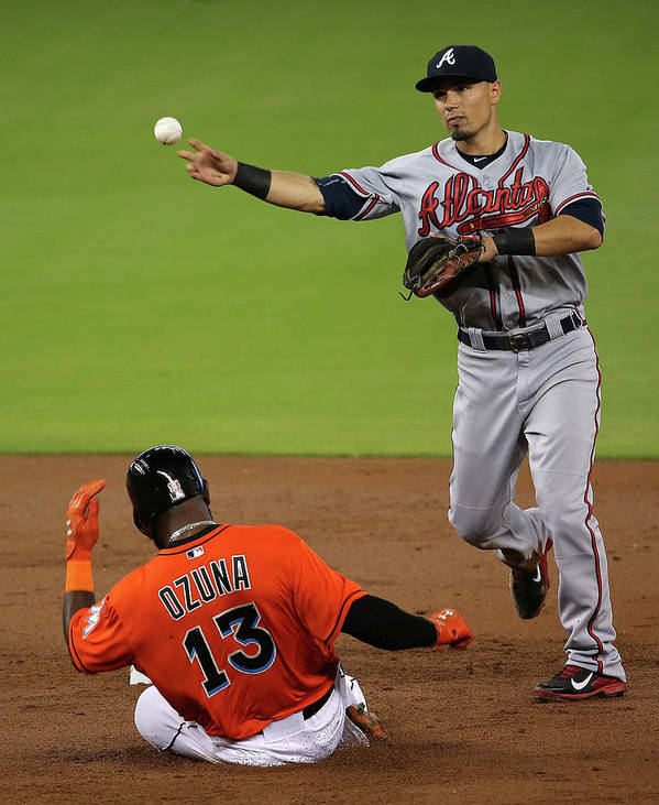 Double Play Poster featuring the photograph Marcell Ozuna And Jace Peterson by Mike Ehrmann