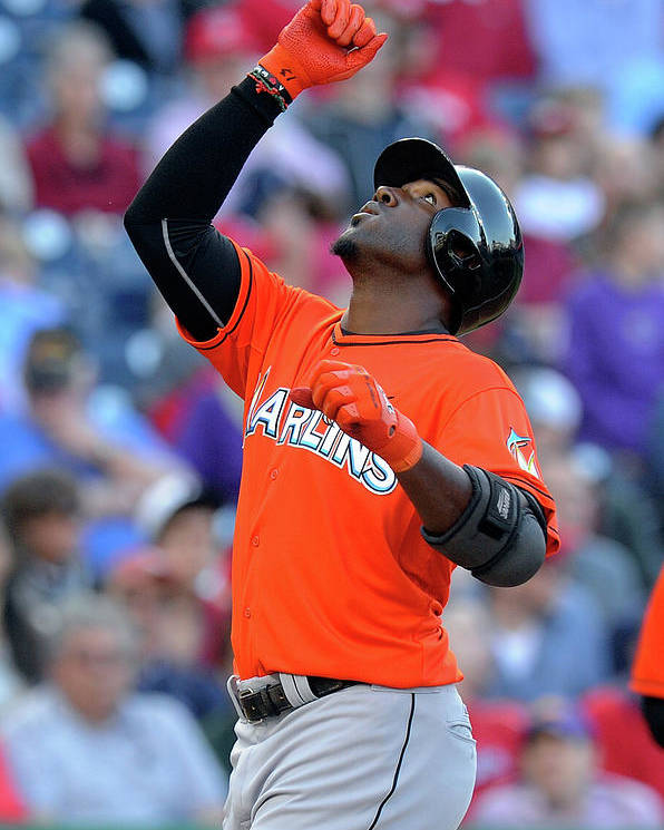 American League Baseball Poster featuring the photograph Marcell Ozuna by Greg Fiume