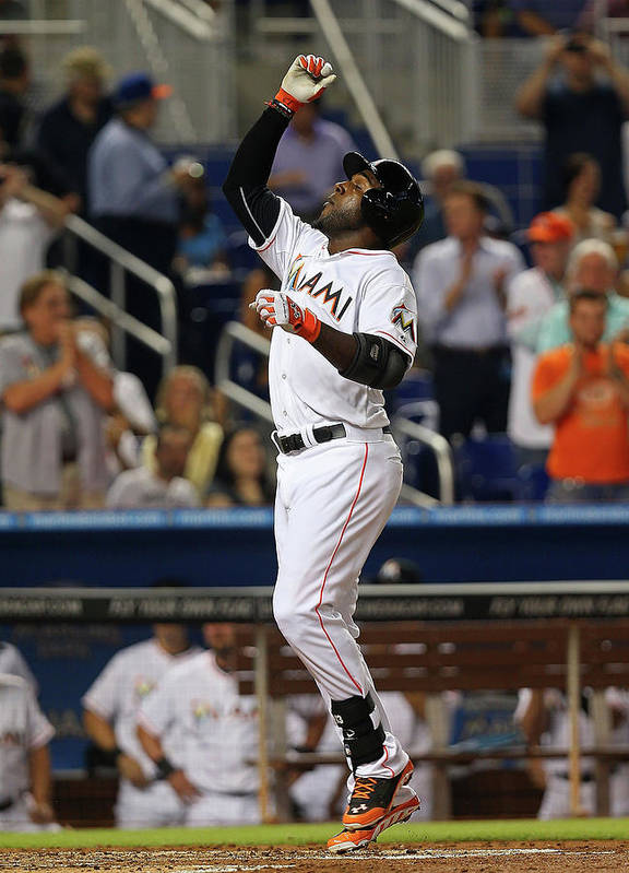 American League Baseball Poster featuring the photograph Marcell Ozuna by Mike Ehrmann
