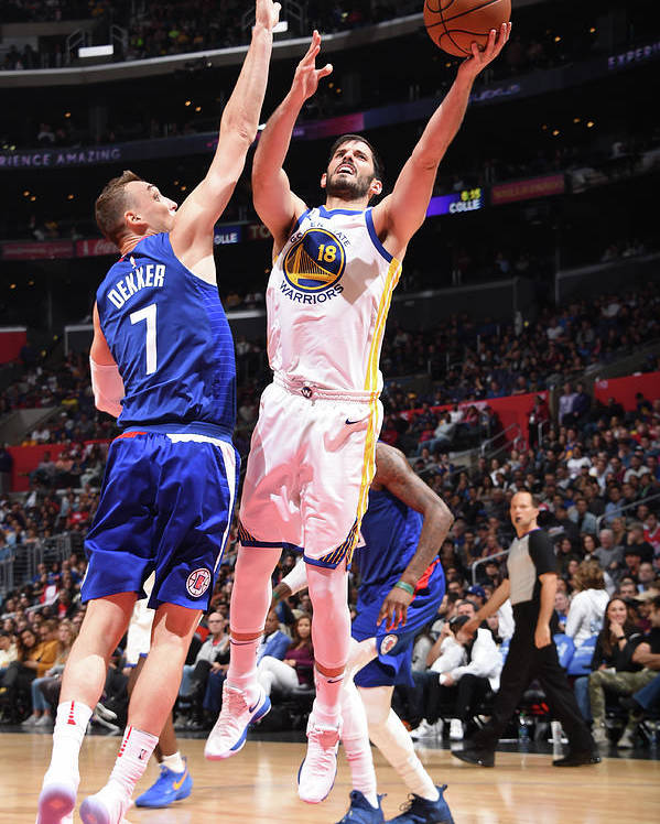 Nba Pro Basketball Poster featuring the photograph Omri Casspi by Andrew D. Bernstein
