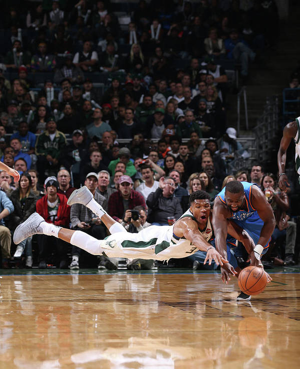Nba Pro Basketball Poster featuring the photograph Raymond Felton and Giannis Antetokounmpo by Gary Dineen