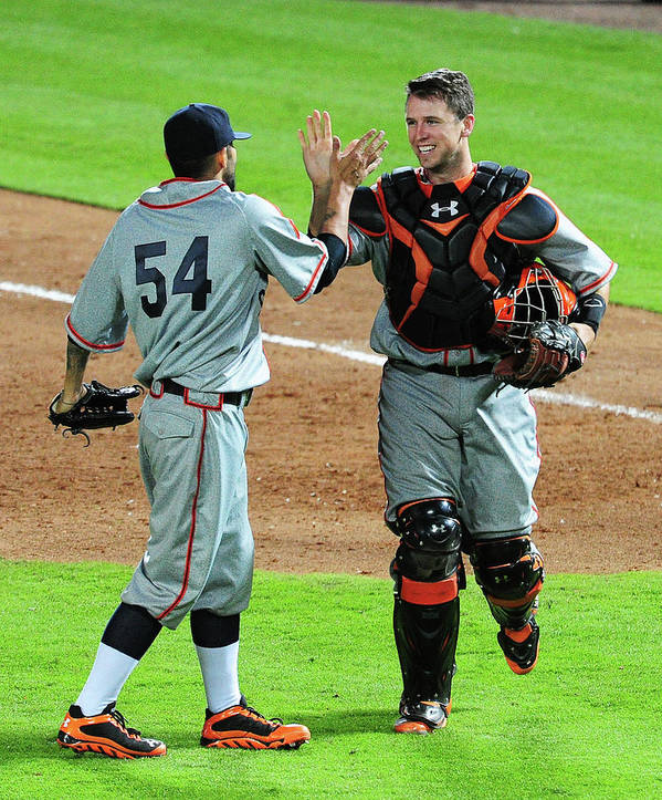 Atlanta Poster featuring the photograph Sergio Romo And Buster Posey by Scott Cunningham