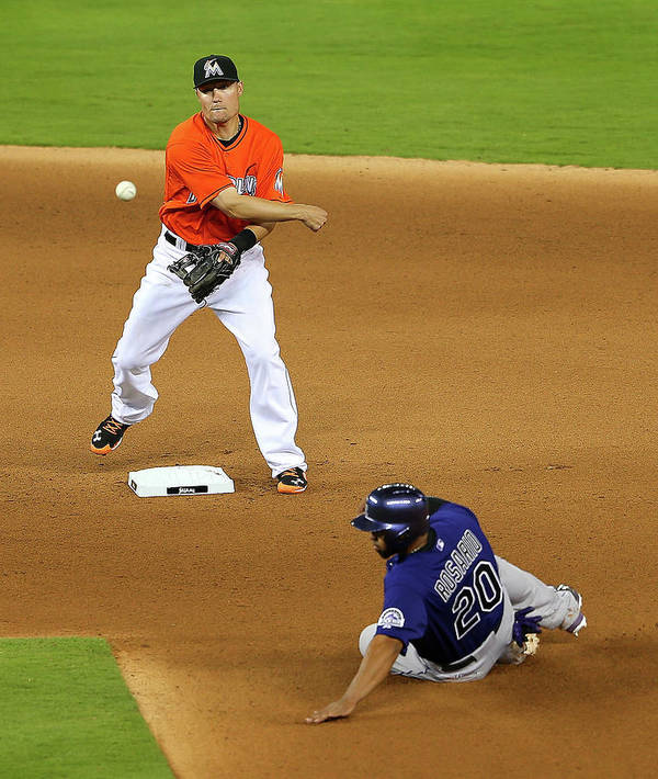 Double Play Poster featuring the photograph Wilin Rosario by Mike Ehrmann