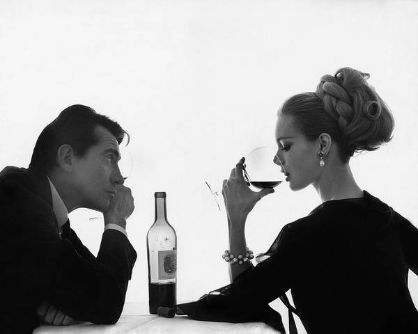 Entertainment Poster featuring the photograph Man Gazing at Woman Sipping Wine by Bert Stern