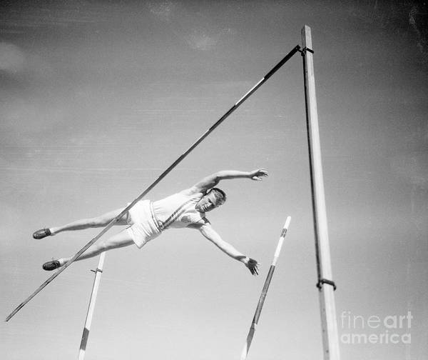 The Olympic Games Poster featuring the photograph Bill Miller Pole Vaulting by Bettmann