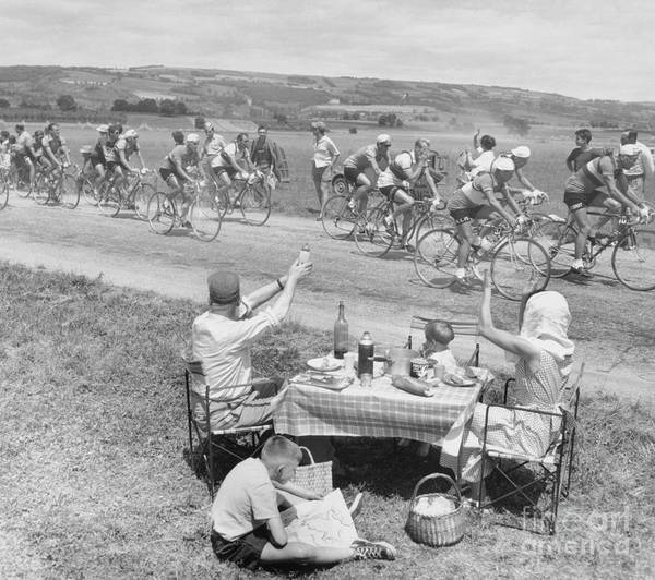 Child Poster featuring the photograph Picnicking Family Greets Tour De France by Bettmann