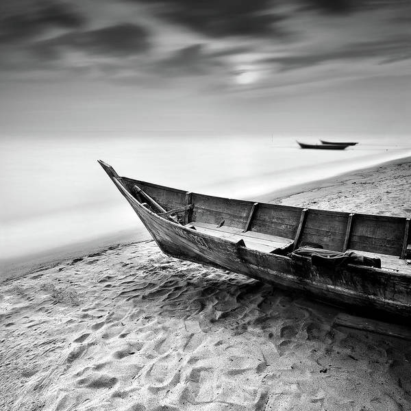 Tranquility Poster featuring the photograph Fisherman Boat At Beach In Black And by Photography By Azrudin