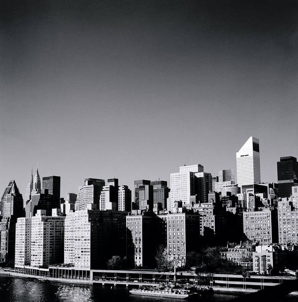 New York Poster featuring the photograph Manhattan by Shaun Higson