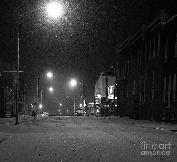 Black And White Photography Poster featuring the photograph Snowing On W. Fourth St. by Julie Dant