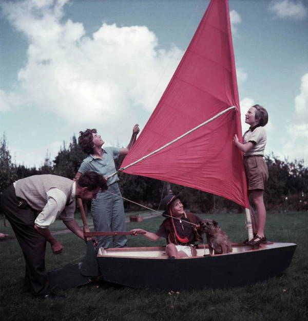 Child Poster featuring the photograph Grass Boat by A. E. French/Archive Photos