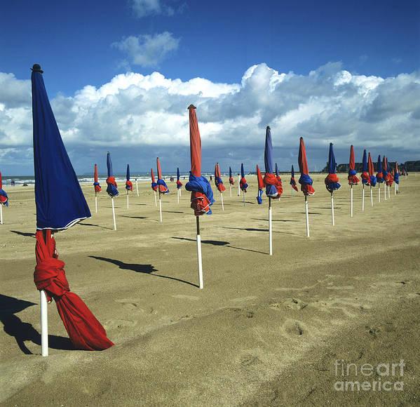 Watersides Poster featuring the photograph Sunshade On The Beach. Deauville. Normandy by Bernard Jaubert