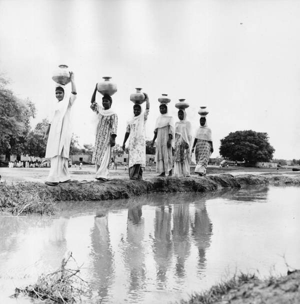 Mid Adult Poster featuring the photograph Water Carriers by Three Lions