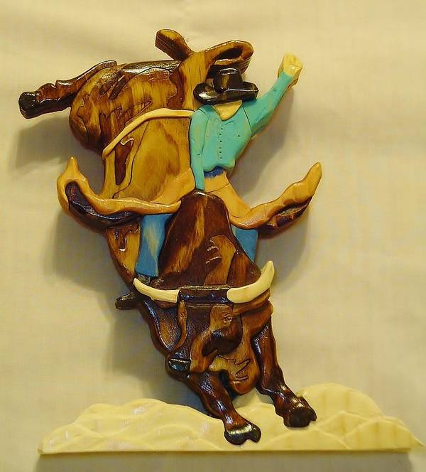Wood Sculpture Poster featuring the sculpture Intarsia Bull-rider by Russell Ellingsworth
