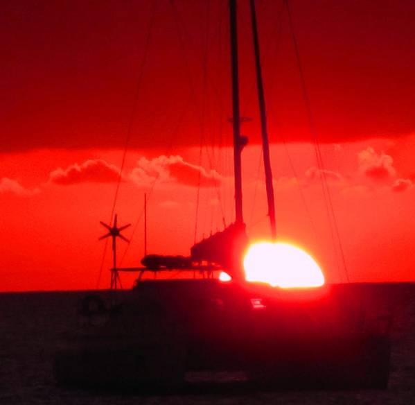 Sunset Poster featuring the photograph Slipping Over The Edge by Ian MacDonald