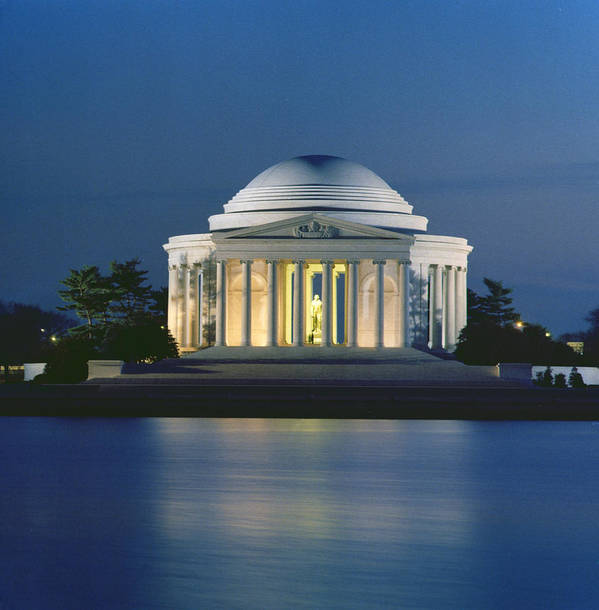 Monument; Saucer Dome; Portico; Columns; Architecture; Architectural; West Potomac Park; Evening; Dusk; Nighttime; Statue; River; Riverbank; Reflection; Nocturne; 3rd; American; Architecture; Neo-classical Poster featuring the photograph The Jefferson Memorial by Peter Newark American Pictures