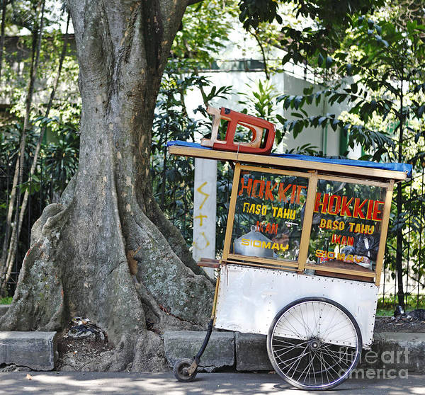 Wheels Poster featuring the photograph A Street Food Vendor Selling Fried by Gwoeii