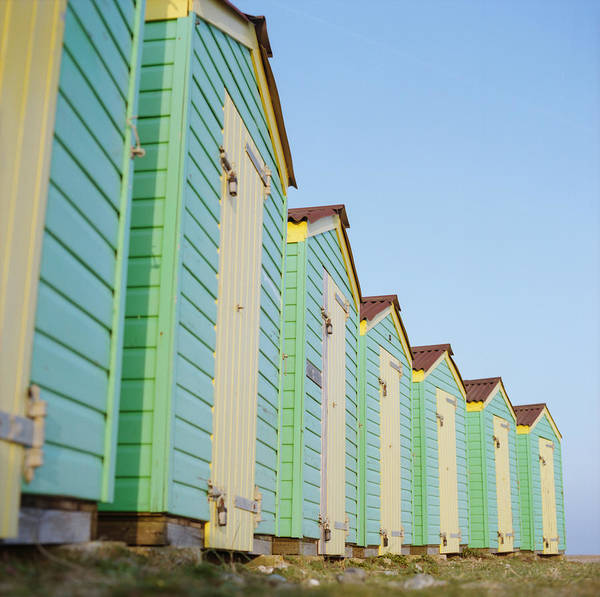 Beach Hut Poster featuring the photograph Beach Huts by Photography By Andrew Mwai