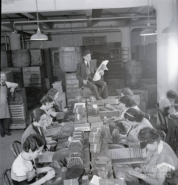 Working Poster featuring the photograph Man Reading Newspaper To Cigar Workers by Bettmann