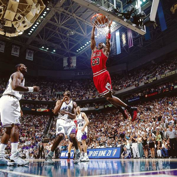 Chicago Bulls Poster featuring the photograph Michael Jordan Attempts A Dunk by Nathaniel S. Butler