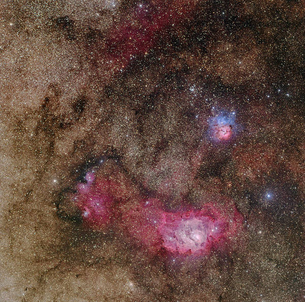 Dust Poster featuring the photograph Trifid Nebula And Lagoon Nebula by Phillip L Jones