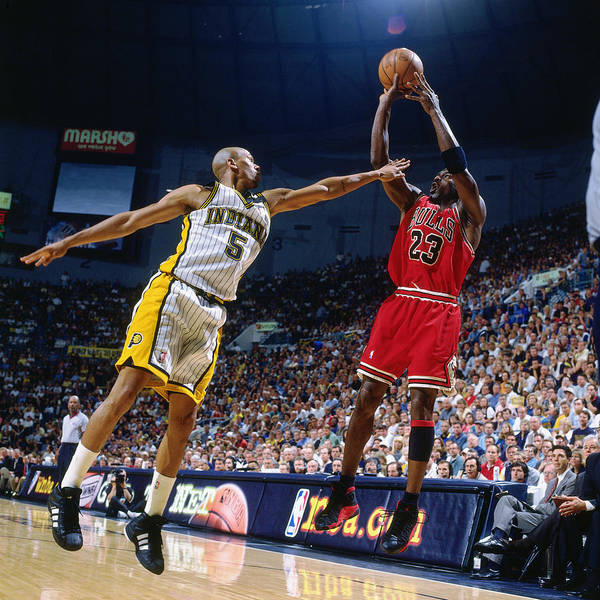Chicago Bulls Poster featuring the photograph Jalen Rose and Michael Jordan by Nathaniel S. Butler