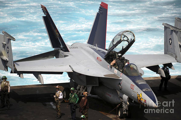 Military Poster featuring the photograph An Fa-18f Super Hornet Sits by Stocktrek Images
