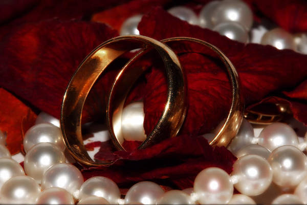 Gold Rings Poster featuring the photograph Wedding Bands And Rose Petals by Tracie Kaska