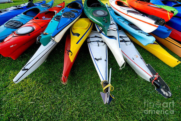 A Lot Art Print featuring the photograph A Stack Of Kayaks by Amy Cicconi