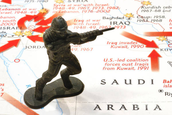 Aggression Art Print featuring the photograph Army Man Standing On Middle East Conflicts Map by Amy Cicconi
