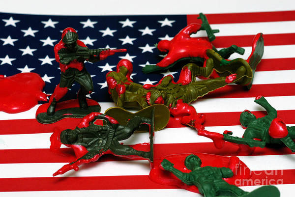 Against The War Art Print featuring the photograph Fallen Toy Soliders On American Flag by Amy Cicconi