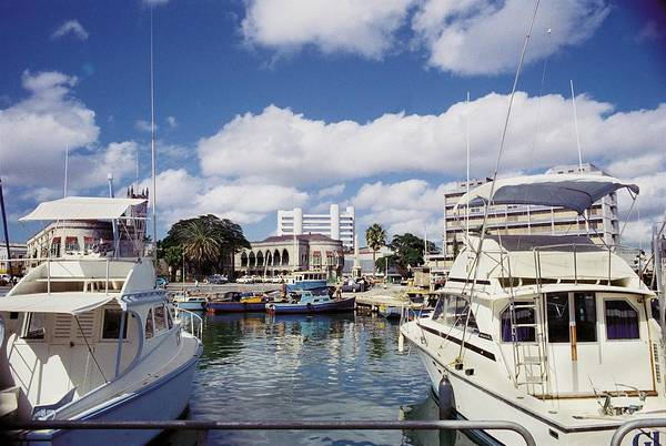 Barbados West-indies Caribbean Bridgetown Capital City Waterfront Cafe Tourism Tourist Resort Public Buildings Parliament Central Bank Building Day-cruisers Anchorage Art Print featuring the photograph View From Waterfront Cafe by Ronald Griffith