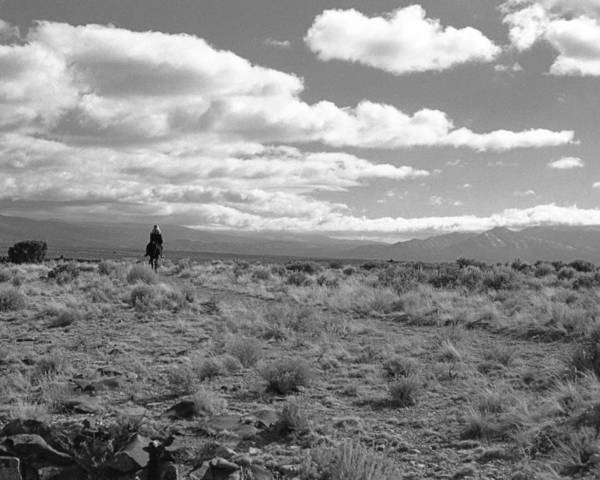 Taos Art Print featuring the photograph Lone Rider West Of Taos by Troy Montemayor