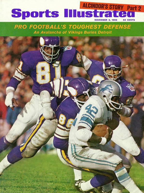 Sports Illustrated Art Print featuring the photograph Minnesota Vikings Defense Sports Illustrated Cover by Sports Illustrated